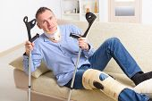 picture of knee  - Man with leg in neck brace - JPG