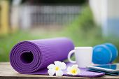 picture of yoga mat  - yoga mat and a cup of coffee in the garden - JPG
