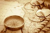 foto of longitude  - Compass and glasses on vintage map - JPG