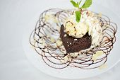 stock photo of brownie  - isolated homemade brownies cake with ice cream on top - JPG