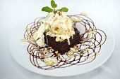 foto of brownie  - isolated homemade brownies cake with ice cream on top - JPG