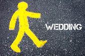 image of pedestrians  - Yellow pedestrian figure on the road walking towards WEDDING - JPG