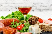 image of charcuterie  - charcuterie plate with wine bread and tomatoes - JPG