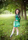 pic of wig  - Young beautiful girl in irish dance dress and wig posing outdoor - JPG