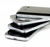 stock photo of cross-section  - Stack of Contemporary Black Smartphones with Silver Details Cross Section on white background - JPG