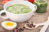 pic of pesto sauce  - sauce of pesto near a tomato olive oil and eggs in a studi - JPG