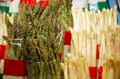 stock photo of white asparagus  - Group of white and green asparagus as a background - JPG
