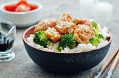 stock photo of stir fry  - teriyaki chicken and broccoli stir fry with rice - JPG