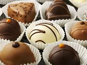 picture of chocolate fudge  - close up shot of chocolates in a row bon bon - JPG
