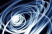 picture of swirly  - Blue swirly lines on black background  - JPG