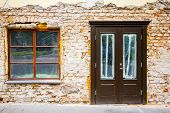 picture of windows doors  - Old weathered street wall with a window and door - JPG