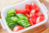 pic of cucumber slice  - Slice cucumber and slice tomato in plastic lunch box - JPG