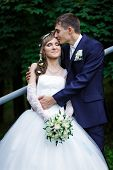 pic of forehead  - Groom gently kissing bride at a forehead - JPG
