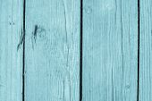 stock photo of pale  - abstract texture of pale blue color of old boards with cracks and with rusty nails for empty and pure backgrounds - JPG
