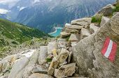 image of trailblazer  - Beautiful alpine landscape with trail blazing and azure mountain lake in the background - JPG
