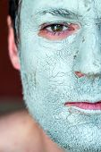 pic of face mask  - Men face closeup on facial blue clay mask - JPG