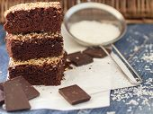 stock photo of brownie  - Chocolate brownie cake with coconut - JPG