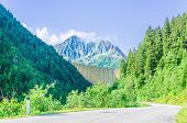 stock photo of dam  - Great dam on the background of the high peaks of the Alps - JPG