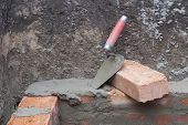 picture of trowel  - against the background of the brickwork is trowel - JPG