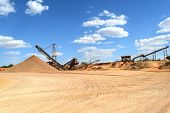 picture of heavy equipment  - Heavy equipment being used at a rock quarry - JPG