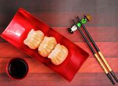 stock photo of siomai  - Vietnam style steamed shrimp dumplings served on a wood table top - JPG