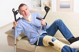 picture of neck brace  - Man with leg in neck brace - JPG