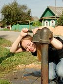 picture of water well  - girl drink water from water - JPG