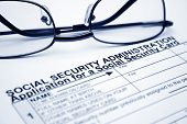 pic of social-security  - Close up of glasses on Social security card application