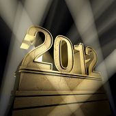 stock photo of new years celebration  - Number 2012 on a golden pedestal at a black background - JPG