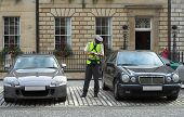 picture of mandate  - parking attendant traffic warden getting parking ticket parking ticket fine mandate - JPG