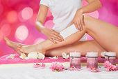 Beautician Waxing Womans Leg In Salon poster