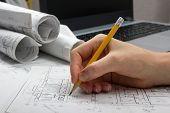 Architect working on blueprint. Architects workplace - architectural project, blueprints, ruler, cal poster