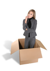 image of thinking outside box  - a business woman thinking outside the box - JPG