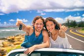 Road trip travel couple showing car keys on summer vacation. Happy young people adventure lifestyle. poster