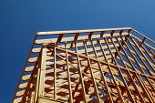 New Home Construction. Build With Wooden Truss, Post And Beam Framework. poster