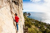 A Man Climbs The Rock. poster