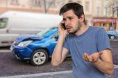 Sad Man Is Calling To Assistance After Car Accident. poster