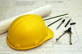stock photo of structural engineering  - floor plans and a hard hat with various drawing tools  - JPG