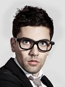 stock photo of nerd glasses  - Portrait of a young and fashion businessman with nerd glasses - JPG