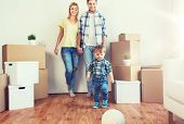 mortgage, people, housing, moving and real estate concept - happy family with boxes playing ball at  poster