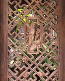 stock photo of swastika  - Vintage Chinese lattice window with Buddhist carvings and swastika symbols  - JPG