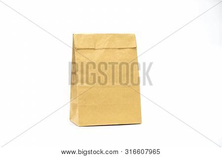 poster of Brown Paper Bag On White Background. Eco Bag. Recycle Paper Bag. Paper For Meal. Paper Bag For Fast