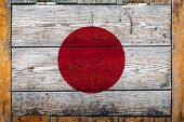 National Flag Of Japan On A Wooden Wall Background.the Concept Of National Pride And Symbol Of The C poster