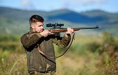 Hunter Hold Rifle. Focus And Concentration Of Experienced Hunter. Hunting And Trapping Seasons. Hunt poster