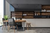 Gray And Wooden Kitchen With Counters And Table poster