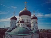 Golden Domes With A Crosses On The Christian Orthodox Church Shine On A Sunny Day Against Blue Sky.  poster