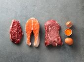 Carnivore Or Keto Diet Concept. Raw Ingredients For Zero Carb Or Low Carb Diet - Rib Eye, Salmon Ste poster