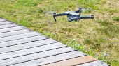 A small FPV racing drone is ready to fly  poster