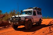 Western Australia – Outback track with 4WD car downhill to the ocean at Dampier Peninsula  poster