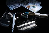 Drug Trafficking, Crime, Addiction And Sale Concept - Closeup Of With Drugs And Money. poster